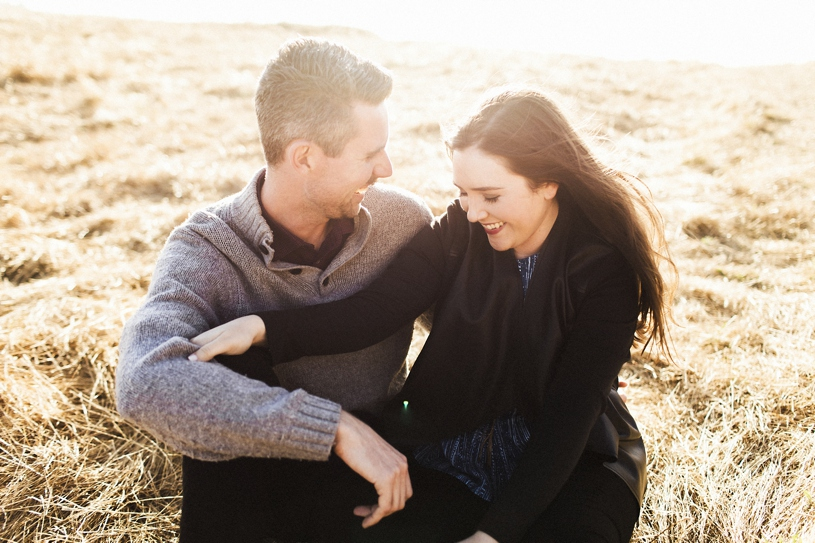Sunset windy engagement session at the Concord Coastline by Heather Elizabeth Photography