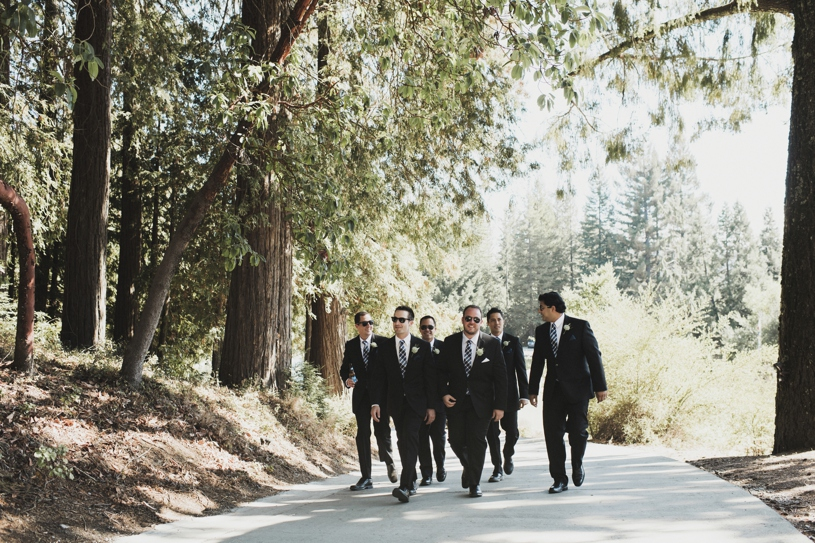 Groomsmen walking to a wedding at Pema Osel Ling by Heather Elizabeth Photography