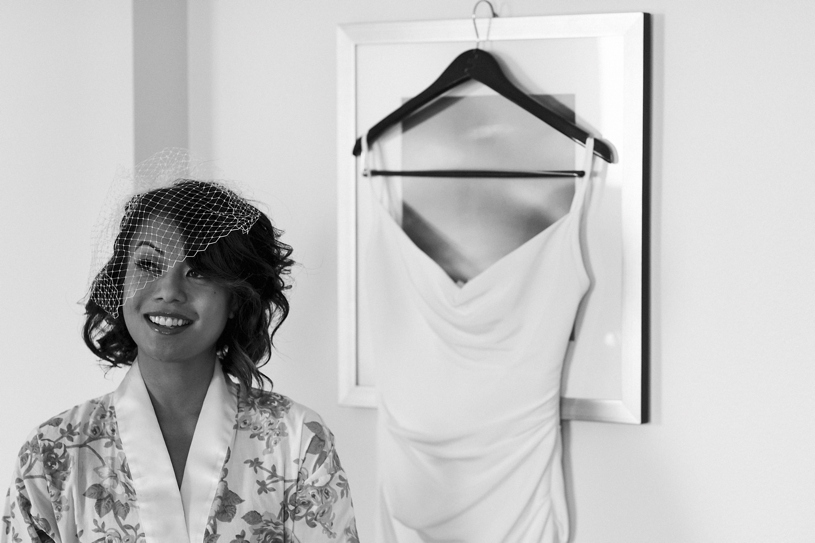 a bride and her slinky sexy wedding dress at the Fairmont in San Francisco by Heather Elizabeth Photography