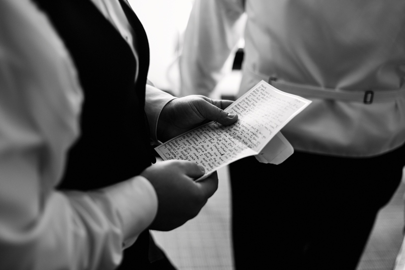 Photo journalistic wedding photo of a groom reading a letter from his bride to be before his wedding in Burlingame by Heather Elizabeth Photography