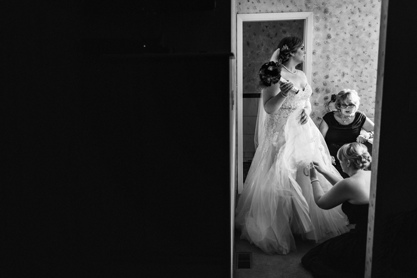 A bride in a Sophia Tolli dress preparing for her wedding in the Bay Area, California by Heather Elizabeth Photography