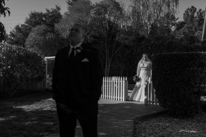 Bride in a Sophia Tolli walking to her first look moment with her groom in Burlingame, California by Heather Elizabeth Photography