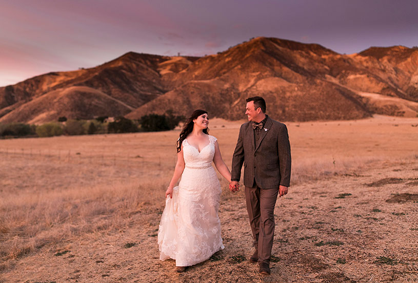 A sunset portrait session for a bride and groom at their Up! Themed country wedding at the Bar Z Ranch by Heather Elizabeth Photography