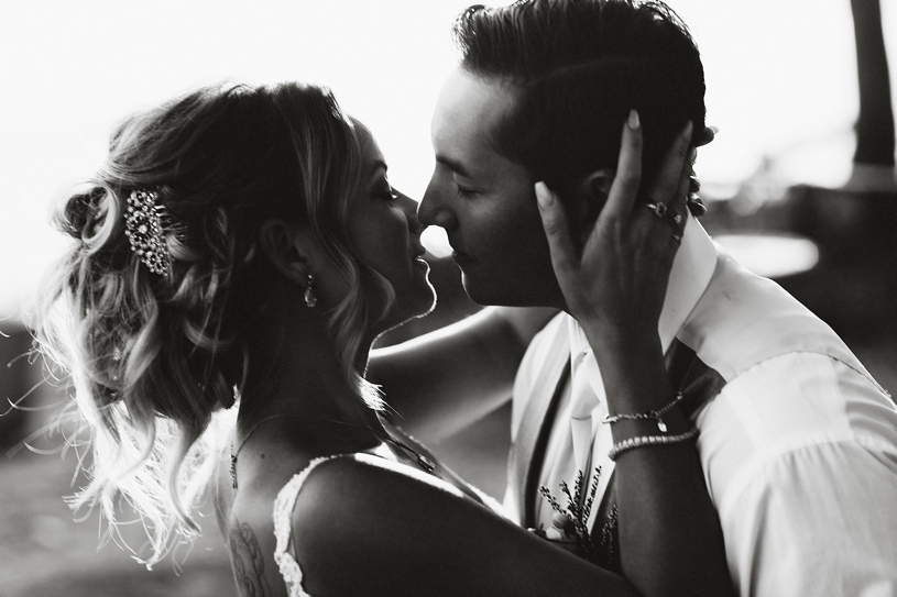 a cinematic wedding portrait between bride and groom at the Seascape beach resort by heather elizabeth photography
