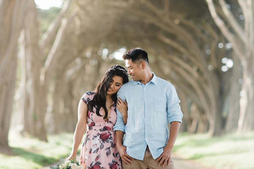 romantic whimsical engagement session with dogs at the Point Reyes tree tunnel