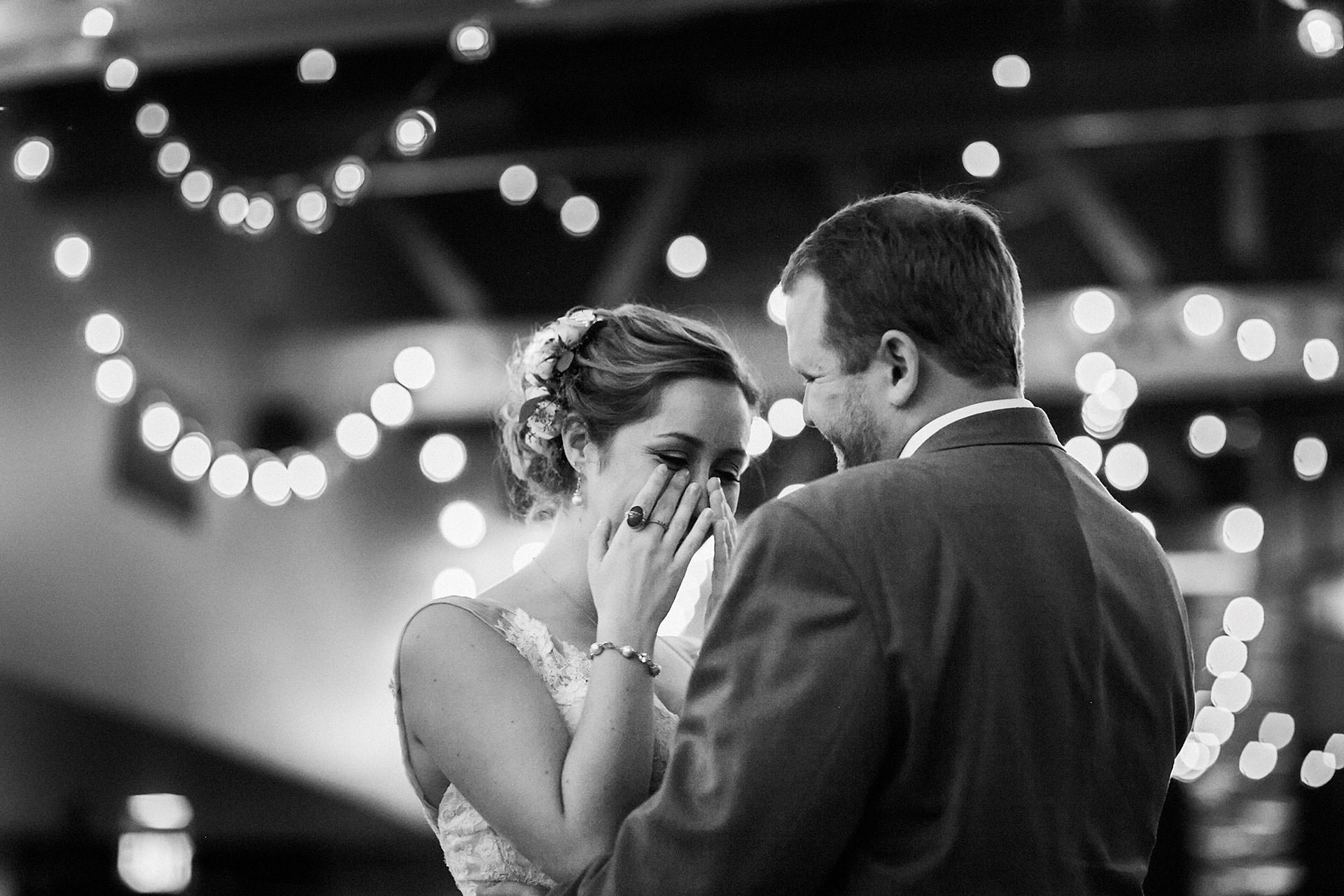 An emotional wedding moment between a couple during their first dance in calistoga california by heather elizabeth photography