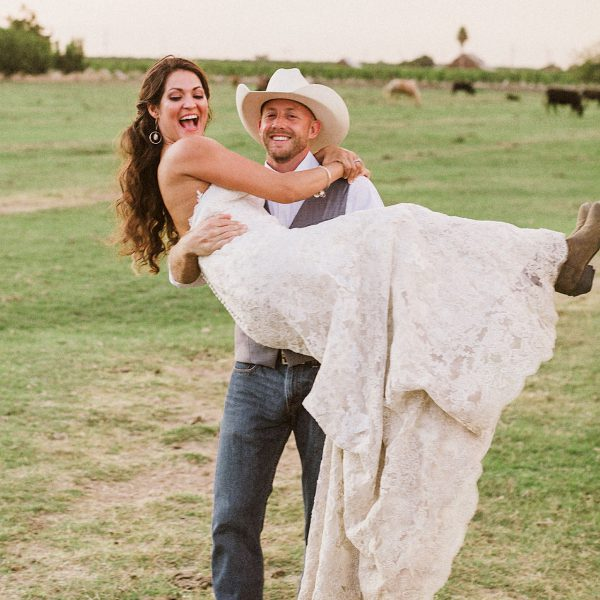 cowboy picking up his beautiful bride at their ranch country rustic wedding in california by heather elizabeth photography