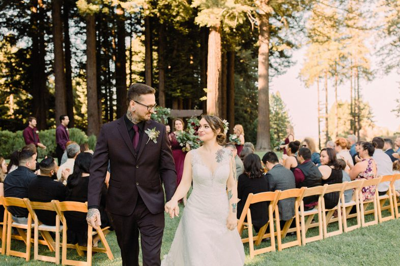 tattooed couple at their bohemian wedding at the mountain terrace by heather elizabeth photography